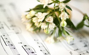 Still life of flowers and sheet music